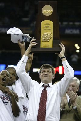 NEW ORLEANS - APRIL 6:  Head coach Geno Auriemma of the University of Connecticut Huskies holds the NCAA National Championship trophy after defeating the Tennessee Lady Vols 70-61 in the National Championship game of the NCAA Women's Final Four Tournament