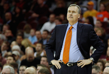 CLEVELAND - FEBRUARY 25:  Head coach Mike D'Antoni of the New York Knicks watches his team play against the Cleveland Cavaliers during the game on February 25, 2011 at Quicken Loans Arena in Cleveland, Ohio. NOTE TO USER: User expressly acknowledges and a