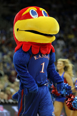 KANSAS CITY, MO - MARCH 10:  The Kansas Jayhawks mascot performs during their quarterfinal game against the Oklahoma State Cowboys in the 2011 Phillips 66 Big 12 Men's Basketball Tournament at Sprint Center on March 10, 2011 in Kansas City, Missouri.  (Ph