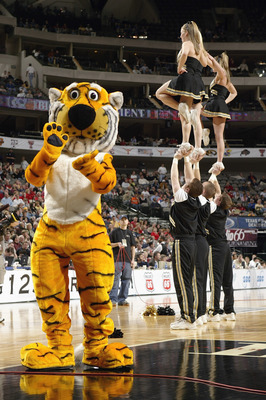 DALLAS - MARCH 11:  The University of Missouri-Columbia Tigers mascot, Truman the Tiger, performs near the Mizzou cheerleaders druing an intermission in the Phillips 66 Big 12 Tournament game against the Texas A&M Aggies at the American Airlines Center on