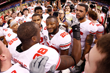 NEW ORLEANS, LA - JANUARY 04:  (L) Solomon Thomas #98 of the Ohio State Buckeyes celebrates with his teammates after he intercepts a pass to seal the 31-26 victory for the Buckeyes against the Arkansas Razorbacks in the Allstate Sugar Bowl at the Louisian