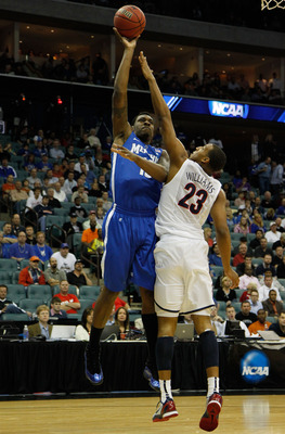 TULSA, OK - MARCH 18:  Tarik Black #10 of the Memphis Tigers takes a shot as Derrick Williams #23 of the Arizona Wildcats defends during the second round game of the 2011 NCAA men's basketball tournament at BOK Center on March 18, 2011 in Tulsa, Oklahoma.