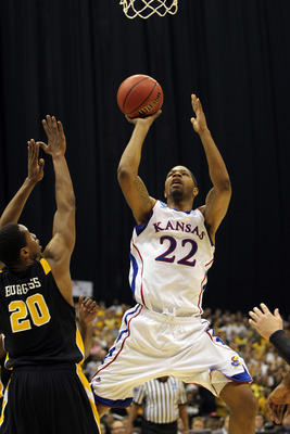 SAN ANTONIO, TX - MARCH 27:  Marcus Morris #22 of the Kansas Jayhawks puts up a shot against Bradford Burgess #20 of the Virginia Commonwealth Rams during the southwest regional final of the 2011 NCAA men's basketball tournament at the Alamodome on March