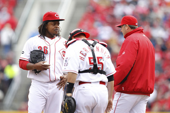 CINCINNATI, OH - MARCH 31: Edinson Volquez #36 of the Cincinnati Reds talks with pitching coach Bryan Price during the opening day game at Great American Ballpark on March 31, 2011 in Cincinnati, Ohio. (Photo by Joe Robbins/Getty Images)