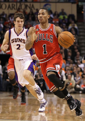 PHOENIX - NOVEMBER 24:  Derrick Rose #1 of the Chicago Bulls handles the ball during the NBA game against the Phoenix Suns at US Airways Center on November 24, 2010 in Phoenix, Arizona. NOTE TO USER: User expressly acknowledges and agrees that, by downloa