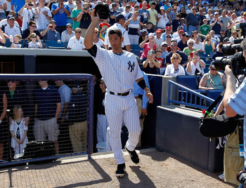 TAMPA, FL - FEBRUARY 26:  Designated hitter Jorge Posada #20 of the New York Yankees tips his hat to the crowd as he is announced just prior to the start of the Grapefruit League Spring Training Game against the Philadelphia Phillies at George M. Steinbre
