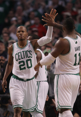BOSTON - NOVEMBER 05:  Ray Allen #20 of the Boston Celtics is congratulated by teammate Glen Davis #11 after Allen drew the foul in the fourth quarter against the Chicago Bulls on November 5, 2010 at the TD Garden in Boston, Massachusetts. The Celtics def