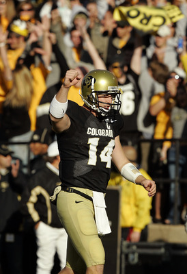 BOULDER, CO - NOVEMBER 5:  Quarterback Joel Klatt #14 of the Colorado Buffaloes celebrates a touchdown against the Missouri Tigers in the second quarter on October 5, 2005 at Folsom Field in Boulder, Colorado.  Colorado won 41-12.  (Photo by Brian Bahr/Ge