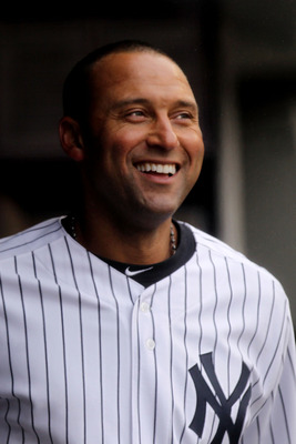 NEW YORK, NY - MARCH 31:  Derek Jeter #2 of the New York Yankees smiles as he looks on from the dugout during the game against the Detroit Tigers on Opening Day at Yankee Stadium on March 31, 2011 in New York City.  (Photo by Nick Laham/Getty Images)