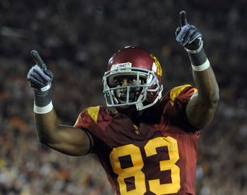 LOS ANGELES, CA - OCTOBER 30: Ronald Johnson #83 of the USC Trojans celebrates his two point conversion for a 32-29 lead over the Oregon Ducks during the third quarter at Los Angeles Memorial Coliseum on October 30, 2010 in Los Angeles, California.  (Phot