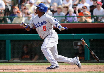 SCOTTSDALE, AZ - MARCH 18:  Juan Uribe #5 of the Los Angeles Dodgers hits fly ball against the San Francisco Giants during the sixth inning of the baseball game at Scottsdale Stadium on March 18, 2011 in Scottsdale, Arizona.  (Photo by Kevork Djansezian/G