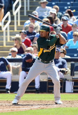 PHOENIX, AZ - MARCH 03:  Coco Crisp #4 of the Oakland Athletics bats against the Milwaukee Brewers during the spring training game at Maryvale Baseball Park on March 3, 2011 in Phoenix, Arizona.  (Photo by Christian Petersen/Getty Images)
