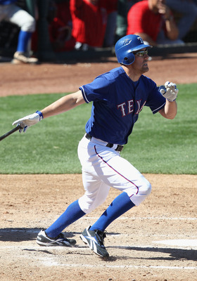 SURPRISE, AZ - MARCH 02:  David Murphy #7 of the Texas Rangers bats against the Los Angeles Angels of Anaheim during the spring training game at Surprise Stadium on March 2, 2011 in Surprise, Arizona.  (Photo by Christian Petersen/Getty Images)