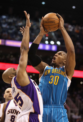 PHOENIX, AZ - JANUARY 30:  David West #30 of the New Orleans Hornets puts up a shot over Vince Carter #25 of the Phoenix Suns during the NBA game at US Airways Center on January 30, 2011 in Phoenix, Arizona.  NOTE TO USER: User expressly acknowledges and
