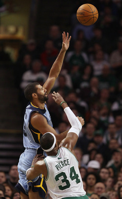 BOSTON, MA - MARCH 23:  Shane Battier #31 of the Memphis Grizzlies shoots over Paul Pierce #34 of the Boston Celtics on March 23, 2011 at the TD Garden in Boston, Massachusetts.  The Memphis Grizzlies defeated the Boston Celtics 90-87. NOTE TO USER: User