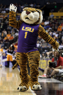 NASHVILLE, TN - MARCH 11: Mike the Tiger, mascot of the LSU Tigers performs against the Tennessee Volunteers during the first round of the SEC Men's Basketball Tournament at the Bridgestone Arena on March 11, 2010 in Nashville, Tennessee.  (Photo by Andy