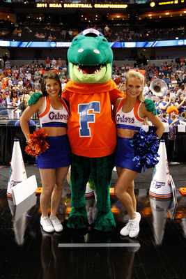 TAMPA, FL - MARCH 19:  Albert, the mascot for the Florida Gators, poses for a photo with 2 FLorida cheerleaders against the UCLA Bruins during the third round of the 2011 NCAA men's basketball tournament at St. Pete Times Forum on March 19, 2011 in Tampa,