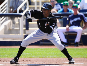 PHOENIX, AZ - MARCH 17: Juan Pierre #1 of the Chicago White Sox looks to bunt the ball against the Milwaukee Brewers during the first inning of the spring training game at Maryvale Baseball Park on March 17, 2011 in Phoenix, Arizona.  (Photo by Kevork Dja