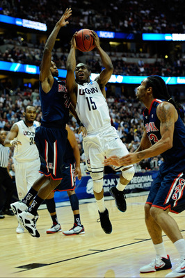 ANAHEIM, CA - MARCH 26:  Kemba Walker #15 of the Connecticut Huskies goes to the basket against Kyle Fogg #21 of the Arizona Wildcats during the west regional final of the 2011 NCAA men's basketball tournament at the Honda Center on March 26, 2011 in Anah