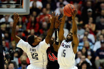 ANAHEIM, CA - MARCH 26:  Kemba Walker #15 and Roscoe Smith #22 of the Connecticut Huskies go up for a rebound against Derrick Williams #23 of the Arizona Wildcats during the west regional final of the 2011 NCAA men's basketball tournament at the Honda Cen