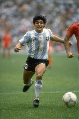 25 Jun 1986:  Diego Maradona of Argentina in action during the World Cup semi-final against Belgium at the Azteca Stadium in Mexico City. Argentina won the match 2-0.  \ Mandatory Credit: Allsport UK /Allsport