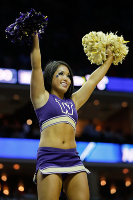 CHARLOTTE, NC - MARCH 18:  A Washington Huskies cheerleader performs while the Huskies take on the Georgia Bulldogs during the second round of the 2011 NCAA men's basketball tournament at Time Warner Cable Arena on March 18, 2011 in Charlotte, North Carol