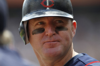 DETROIT - JULY 11:  Jim Thome #25 of the Minnesota Twins looks on during the game against the Detroit Tigers on July 11, 2010 at Comerica Park in Detroit, Michigan. The Twins defeated the Tigers 6-3.  (Photo by Leon Halip/Getty Images)