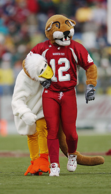 PULLMAN - NOVEMBER 09:   'Butch' the Washington State Cougars mascot has the Oregon Ducks mascot by the neck during the game on November 09, 2002 at Martin Stadium in Pullman Washington. (Photo by Otto Greule Jr/Getty Images)