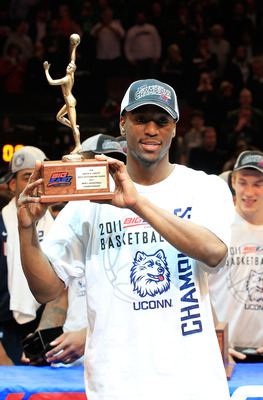 NEW YORK, NY - MARCH 12:  Kemba Walker #15 of the Connecticut Huskies holds up the David R. Gavitt Most Outstanding Player trophy after defeating the Louisville Cardinals during the championship of the 2011 Big East Men's Basketball Tournament presented b
