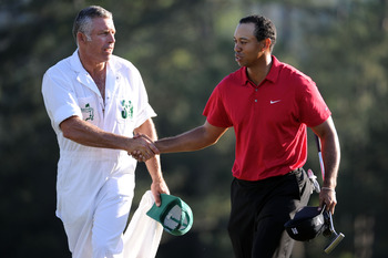 AUGUSTA, GA - APRIL 11:  Tiger Woods walks off the 18th green with his caddie Steve Williams during the final round of the 2010 Masters Tournament at Augusta National Golf Club on April 11, 2010 in Augusta, Georgia.  (Photo by Harry How/Getty Images)