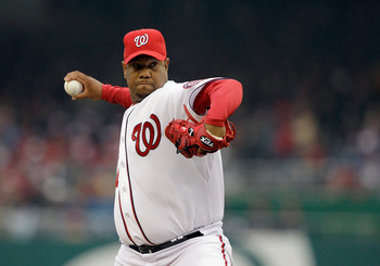 WASHINGTON, DC - MARCH 31:  Starting pitcher Livan Hernandez #61 of the Washington Nationals delivers to an Atlanta Braves batter during the third inning at Nationals Park on March 31, 2011 in Washington, DC.  (Photo by Rob Carr/Getty Images)