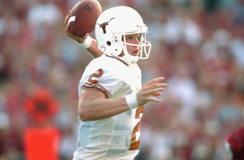 DALLAS - OCTOBER 12:  Quarterback Chris Simms #2 of the Texas Longhorns passes in the pocket against the Oklahoma Sooners on October 12, 2002 at the Cotton Bowl in Dallas, Texas.  Oklahoma defeated Texas 35-24.  (Photo by Harry How/Getty Images)