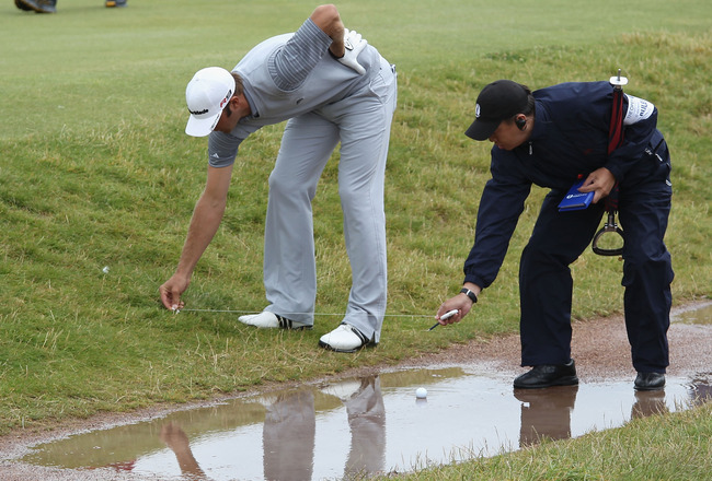 ST ANDREWS, SCOTLAND - JULY 16:  Dustin Johnson of the USA gets a ruling on the 17th hole during the second round of the 139th Open Championship on the Old Course, St Andrews on July 16, 2010 in St Andrews, Scotland.  (Photo by Ross Kinnaird/Getty Images)