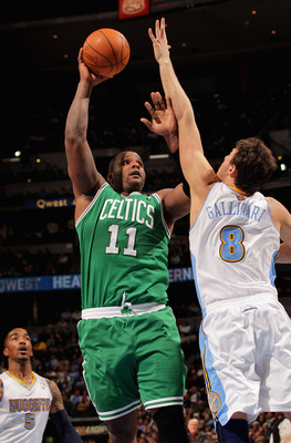 DENVER, CO - FEBRUARY 24:  Glen Davis #11 of the Boston Celtics takes a shot against Danilo Gallinari #8 of the Denver Nuggets during NBA action at the Pepsi Center on February 24, 2011 in Denver, Colorado. NOTE TO USER: User expressly acknowledges and ag