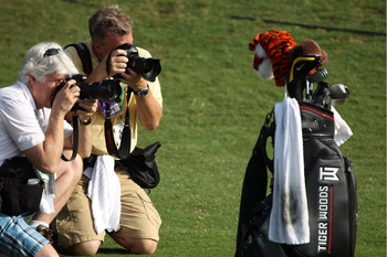 PONTE VEDRA BEACH, FL - MAY 05:  Photographers shoot Tiger Woods' golf bag during a practice round prior to the start of THE PLAYERS Championship held at THE PLAYERS Stadium course at TPC Sawgrass on May 5, 2010 in Ponte Vedra Beach, Florida.  (Photo by S