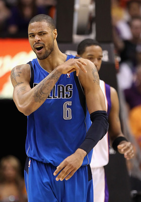 PHOENIX, AZ - MARCH 27:  Tyson Chandler #6 of the Dallas Mavericks reacts during the NBA game against the Phoenix Suns at US Airways Center on March 27, 2011 in Phoenix, Arizona.  The Mavericks defeated the Suns 91-83.  NOTE TO USER: User expressly acknow
