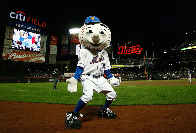 NEW YORK - APRIL 03:  Mr Met  gets the crowd going during an exhibition game between the New York Mets and the Boston Red Sox on April 3, 2009 at Citi Field in the Flushing neighborhood of the Queens borough of New York City. The game marks the first time