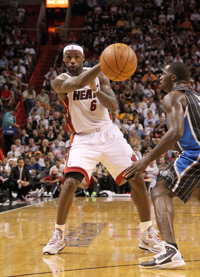 MIAMI, FL - MARCH 03: LeBron James #6 of the Miami Heat passes the ball during a game against the Orlando Magic at American Airlines Arena on March 3, 2011 in Miami, Florida. NOTE TO USER: User expressly acknowledges and agrees that, by downloading and/or