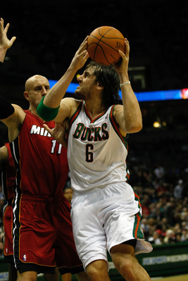 MILWAUKEE, WI - JANUARY 07: Andrew Bogut #6 of the Milwaukee Bucks shoots against the Miami Heat at the Bradley Center on January 7, 2011 in Milwaukee, Wisconsin. NOTE TO USER: User expressly acknowledges and agrees that, by downloading and or using this