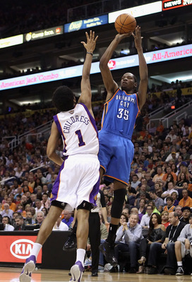 PHOENIX, AZ - MARCH 30:  Kevin Durant #35 of the Oklahoma City Thunder puts up a shot over Josh Childress #1 of the Phoenix Suns during the NBA game at US Airways Center on March 30, 2011 in Phoenix, Arizona.  NOTE TO USER: User expressly acknowledges and