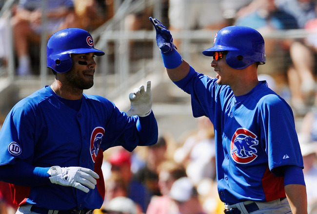 GLENDALE, AZ - MARCH 11: Carlos Pena #22 of the Chicago Cubs is congratulated by Luis Montanez #39 during the second inning of the spring training baseball game at Camelback Ranch on March 11, 2011 in Glendale, Arizona.  (Photo by Kevork Djansezian/Getty