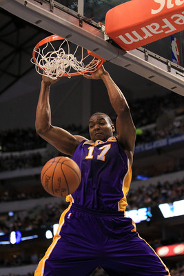 DALLAS, TX - MARCH 12:  Center Andrew Bynum #17 of the Los Angeles Lakers gets the slam dunk against the Dallas Mavericks at American Airlines Center on March 12, 2011 in Dallas, Texas.  NOTE TO USER: User expressly acknowledges and agrees that, by downlo
