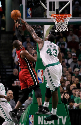 BOSTON - FEBRUARY 13:  Dwyane Wade #3 of the Miami Heat goes to the basket against Kendrick Perkins #43 of the Boston Celtics at TD Garden on February 13, 2011 in Boston, Massachusetts. NOTE TO USER: User expressly acknowledges and agrees that, by downloa