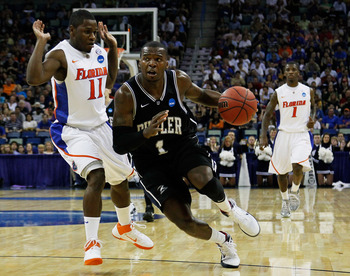 NEW ORLEANS, LA - MARCH 26:  Shelvin Mack #1 of the Butler Bulldogs drives past Erving Walker #11 of the Florida Gators during the Southeast regional final of the 2011 NCAA men's basketball tournament at New Orleans Arena on March 26, 2011 in New Orleans,