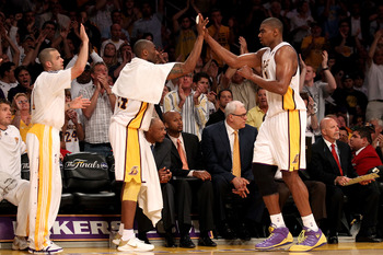 LOS ANGELES, CA - JUNE 06:  Andrew Bynum #17 returns to the bench and is greeted by teammates Kobe Bryant #24 and Jordan Farmar #1 of the Los Angeles Lakers in Game Two of the 2010 NBA Finals against the Boston Celtics at Staples Center on June 6, 2010 in