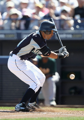 PEORIA, AZ - MARCH 12:  Ichiro Suzuki #51 of the Seattle Mariners reacts as he is hit in the leg by a pitch during the first inning of the spring training game against the Oakland Athletics at Peoria Stadium on March 12, 2011 in Peoria, Arizona.  (Photo b