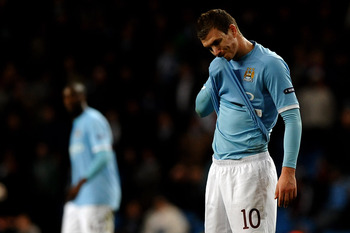 MANCHESTER, ENGLAND - MARCH 17:  Edin Dzeko of Manchester City shows his dejection during the UEFA Europa League round of 16 second leg match between Manchester City and Dynamo Kiev at City of Manchester Stadium on March 17, 2011 in Manchester, England.