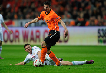 AMSTERDAM, NETHERLANDS - MARCH 29:  Robin Van Persie of the Netherlands battles with Adam Pinter of Hungary during the Group E, EURO 2012 Qualifier between Netherlands and Hungary at the Amsterdam Arena on March 29, 2011 in Amsterdam, Netherlands.  (Photo