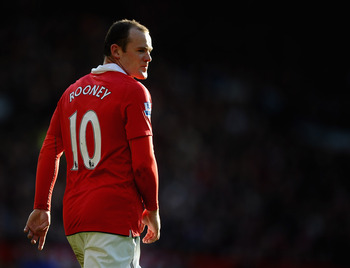 MANCHESTER, ENGLAND - MARCH 19: Wayne Rooney of Manchester United looks on during the Barclays Premier League match between Manchester United and Bolton Wanderers at Old Trafford on March 19, 2011 in Manchester, England.  (Photo by Laurence Griffiths/Gett