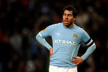 MANCHESTER, ENGLAND - MARCH 17:  Carlos Tevez of Manchester City shuts his eyes during the UEFA Europa League round of 16 second leg match between Manchester City and Dynamo Kiev at City of Manchester Stadium on March 17, 2011 in Manchester, England.  (Ph